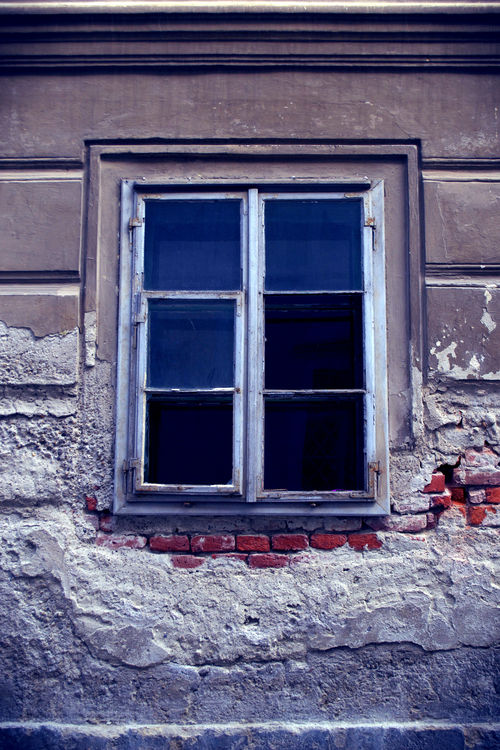 a snow covered building with a large window. croatia, varaždin. buy photo