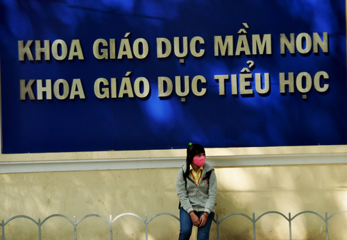 Waiting. signs, students, waiting, fences, vietnam, colleges, saigon, facemasks, hcmchochiminh. buy photo