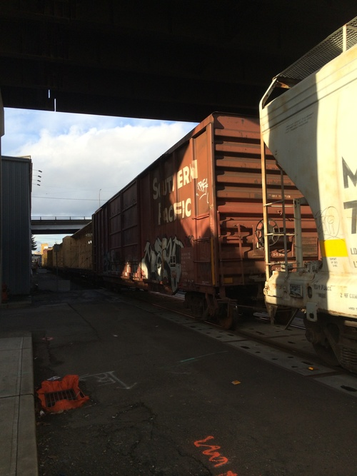 a train car is parked on the side of the road. buy photo