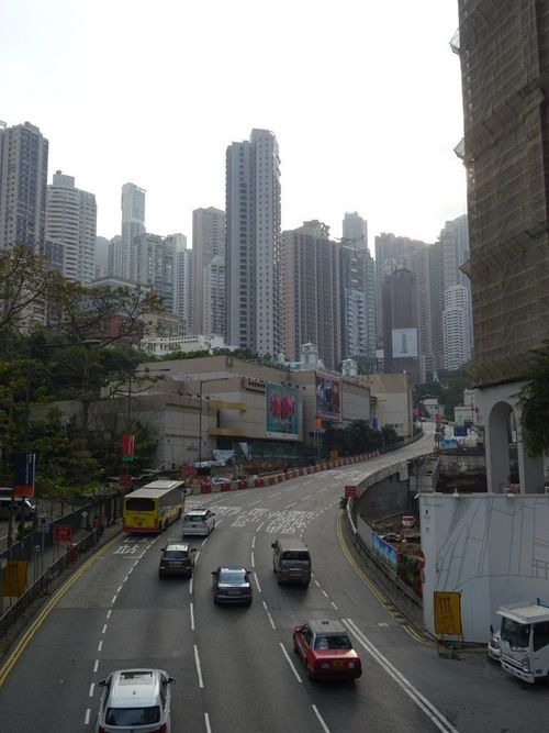 a city street filled with lots of traffic. buy photo