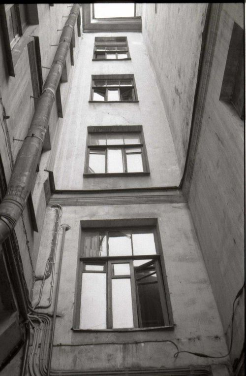 a view of a building with a clock on the side of it. buy photo