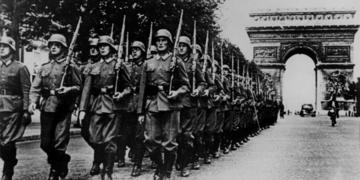 Nazis parade near the Arc de Triomphe of Paris