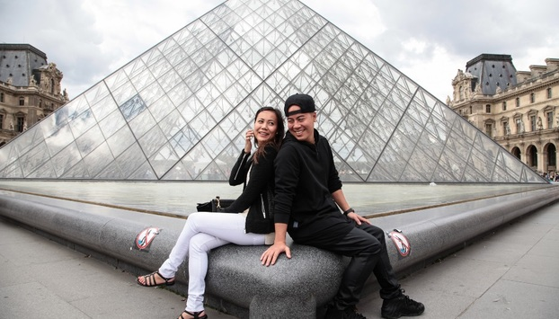 Posing at the Louvre Pyramid on our Paris Photo Shoot