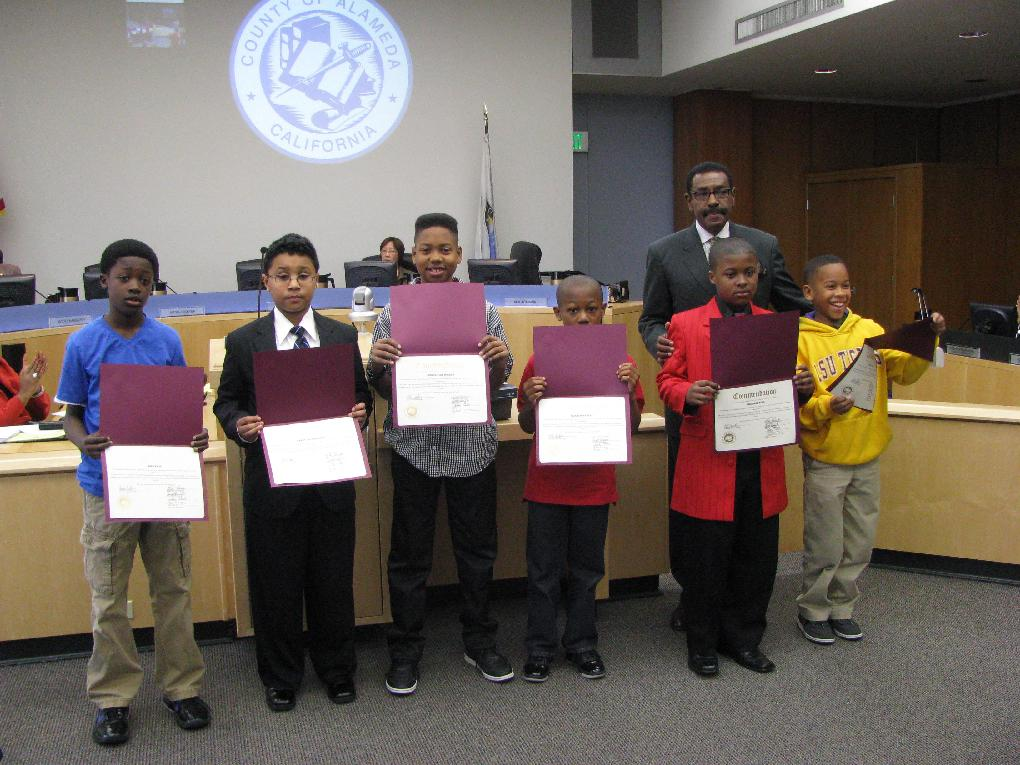 Supervisor Carson honors young boys from Oakland who received perfect scores on the STAR exam in 2011