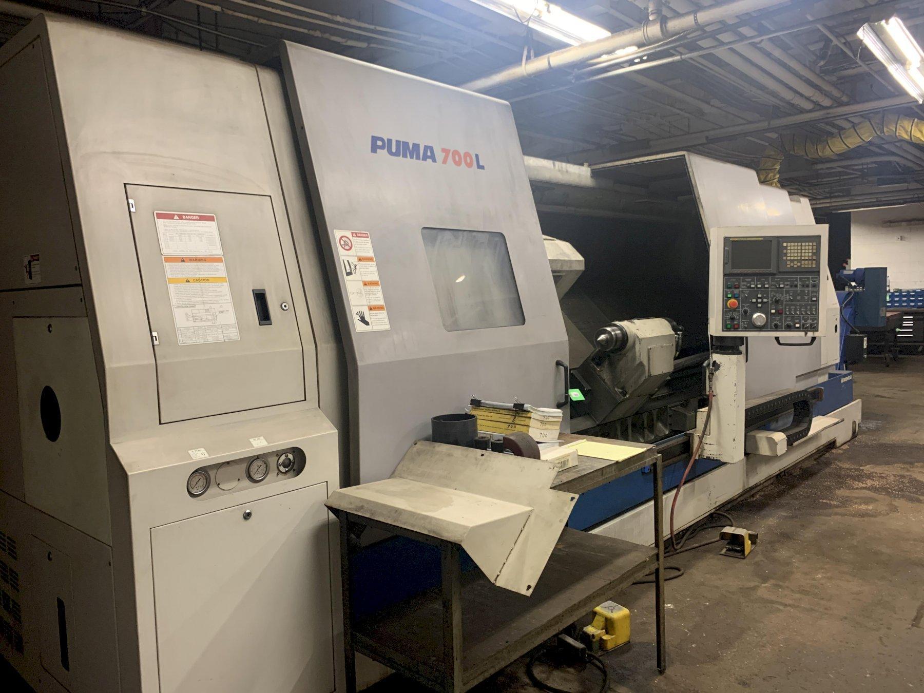"""Doosan Puma 700L CNC Lathe, Fanuc 21iTB, 24"""" Chuck, 6.1"""" Bar Capacity, 126"""" Centers, 12 Position"""