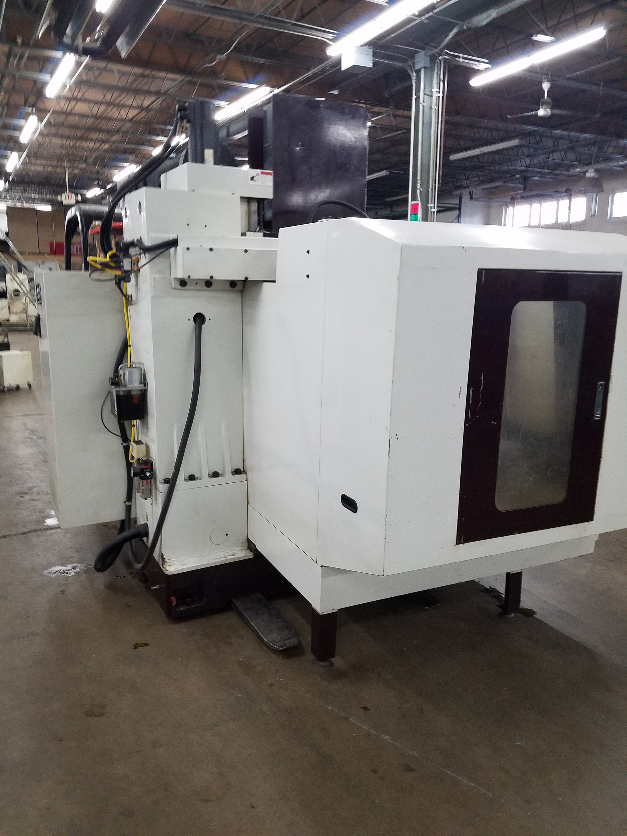 """40"""" x 20"""" Chevalier CNC Vertical Machining Center.  New Anilam Control, 20 ATC, Cat #40 Spindle Taper."""