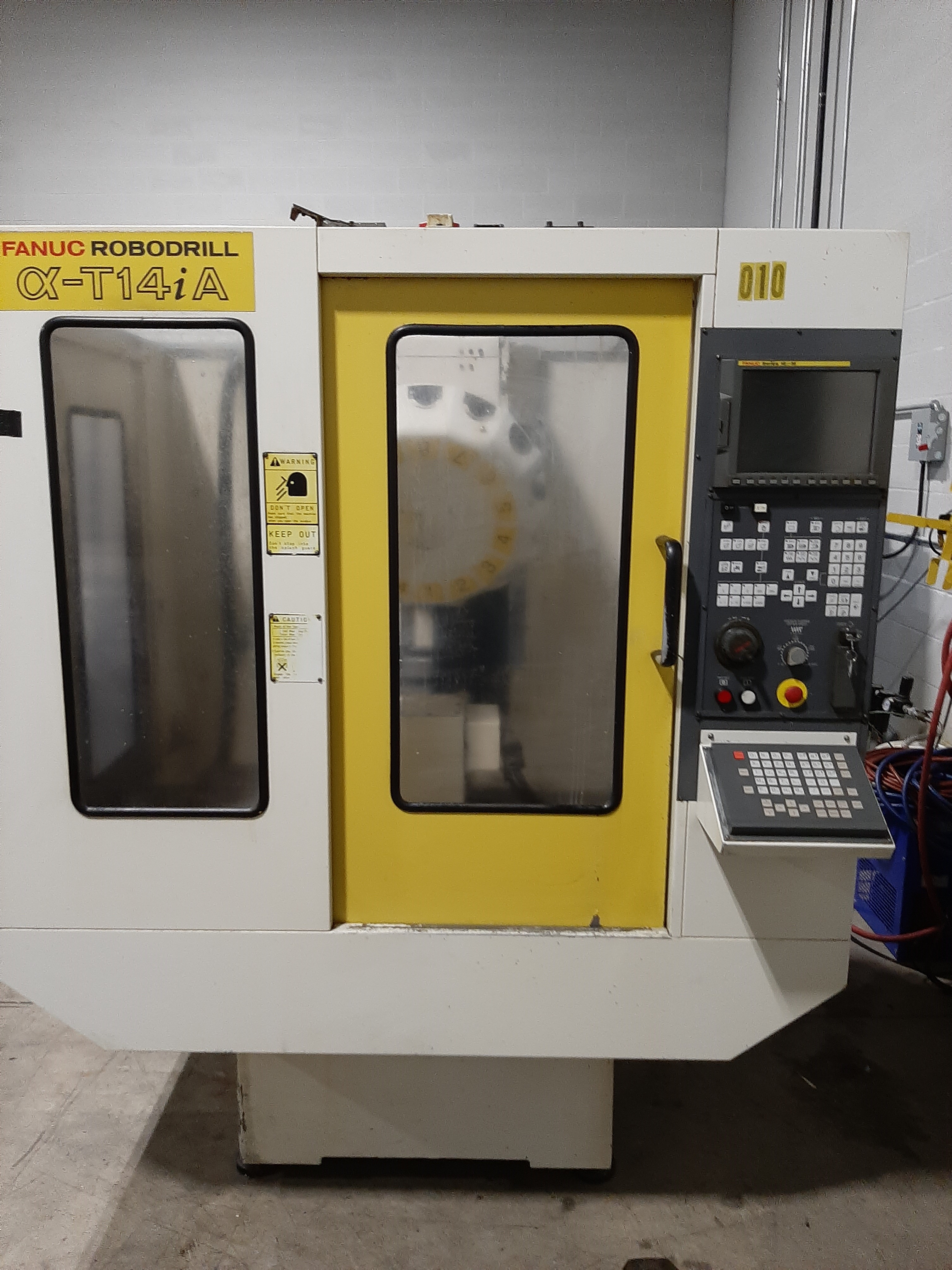 """1997 Fanuc Robodrill Alpha T14i A;  Fanuc 16i M Control; X Axis, 19.7""""; Y Axis  14.9""""; Z Axis 11.8"""";  Table Size: 25.6"""" x 14.9""""; BT 30; 14 Tool ATC; 80-8,000 RPM; 7.5 HP;  Tsudakoma RN150 R 4th Axis Rotary Table,(Needs A Axis Servo Drive)"""
