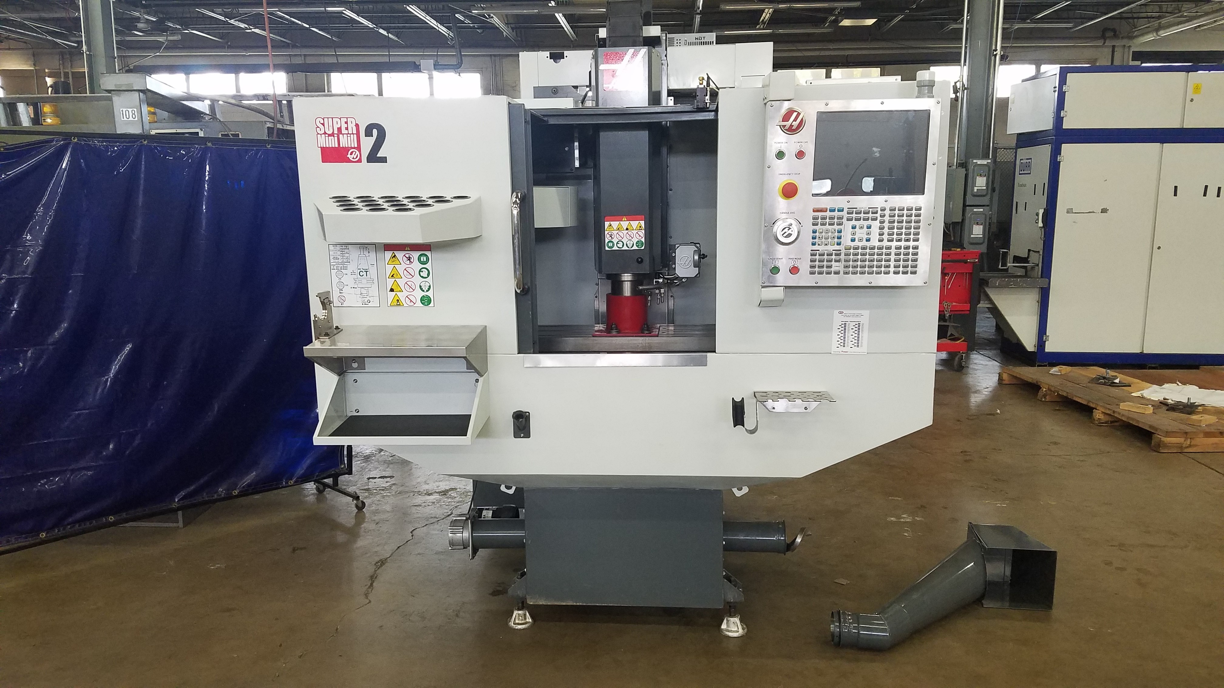Haas 2017 Super Mini Mill 2 with Tool Probe, 20 ATC, High speed tool changer, P-cool, chip auger, Low Hours and manuals