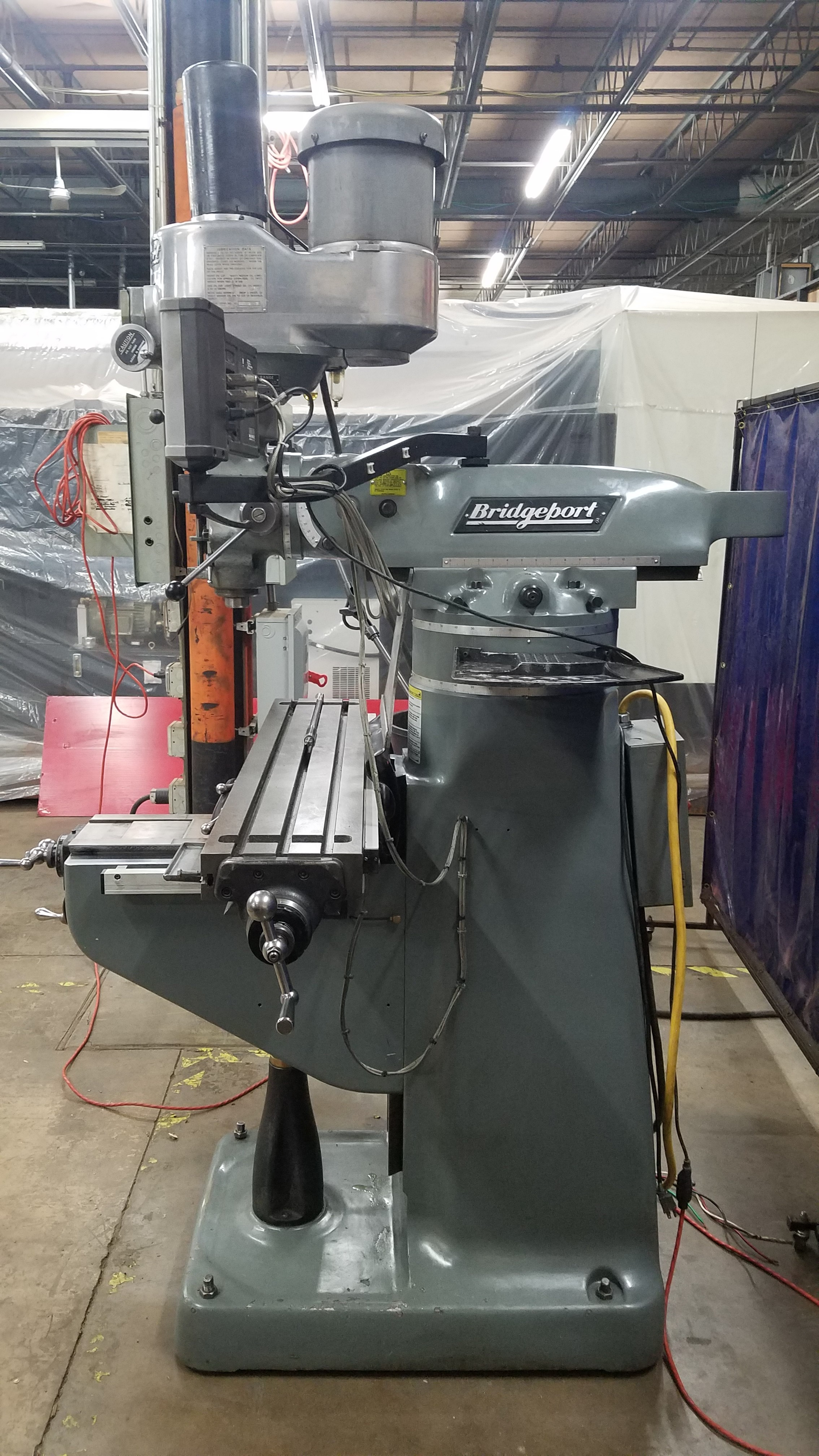 Excellent rebuilt Head, new Spindle bearings, New Servo corp. EVD Electronic variable Drive for Spindle, Well equipped with Power draw bar, Riser and Acu Rite Digital read outs, Currently we have 6 Mills like this in stock to meet any budget
