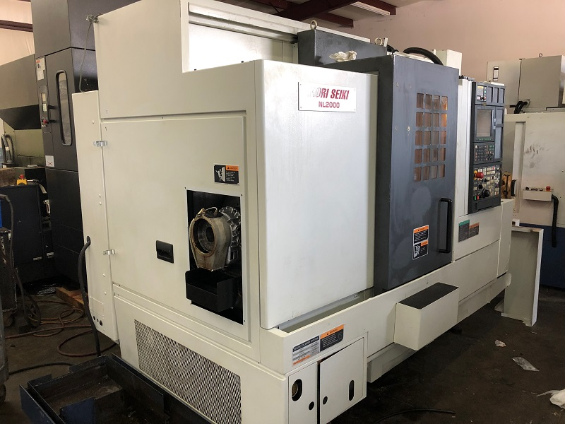 """MORI SEIKI NL-2000Y, '05, MSX850, 2.5"""" Bar, 8"""" Chuck, 5000 RPM, 12 Tools, 25 HP, Y-Axis, Tailstock, Parts Catcher"""