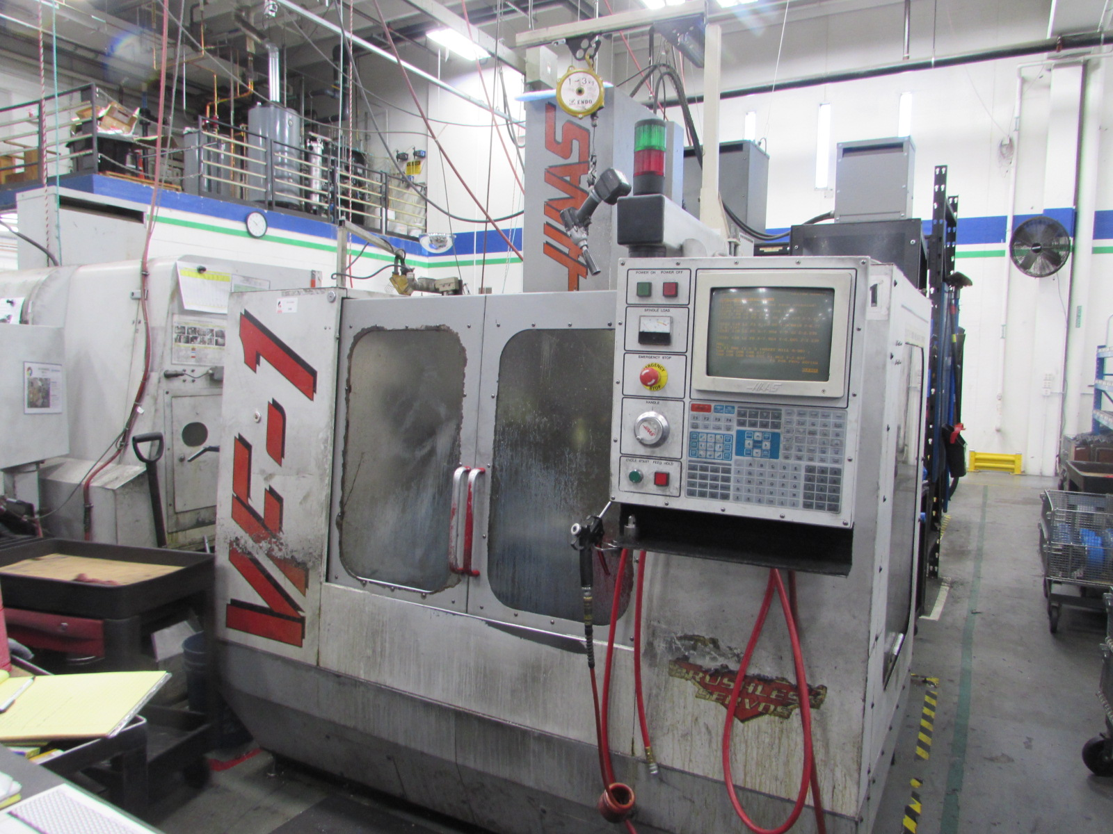 Haas VF-1 CNC Vertical Machining Center with Brushed Type 4th Axis Drive and Chip Auger