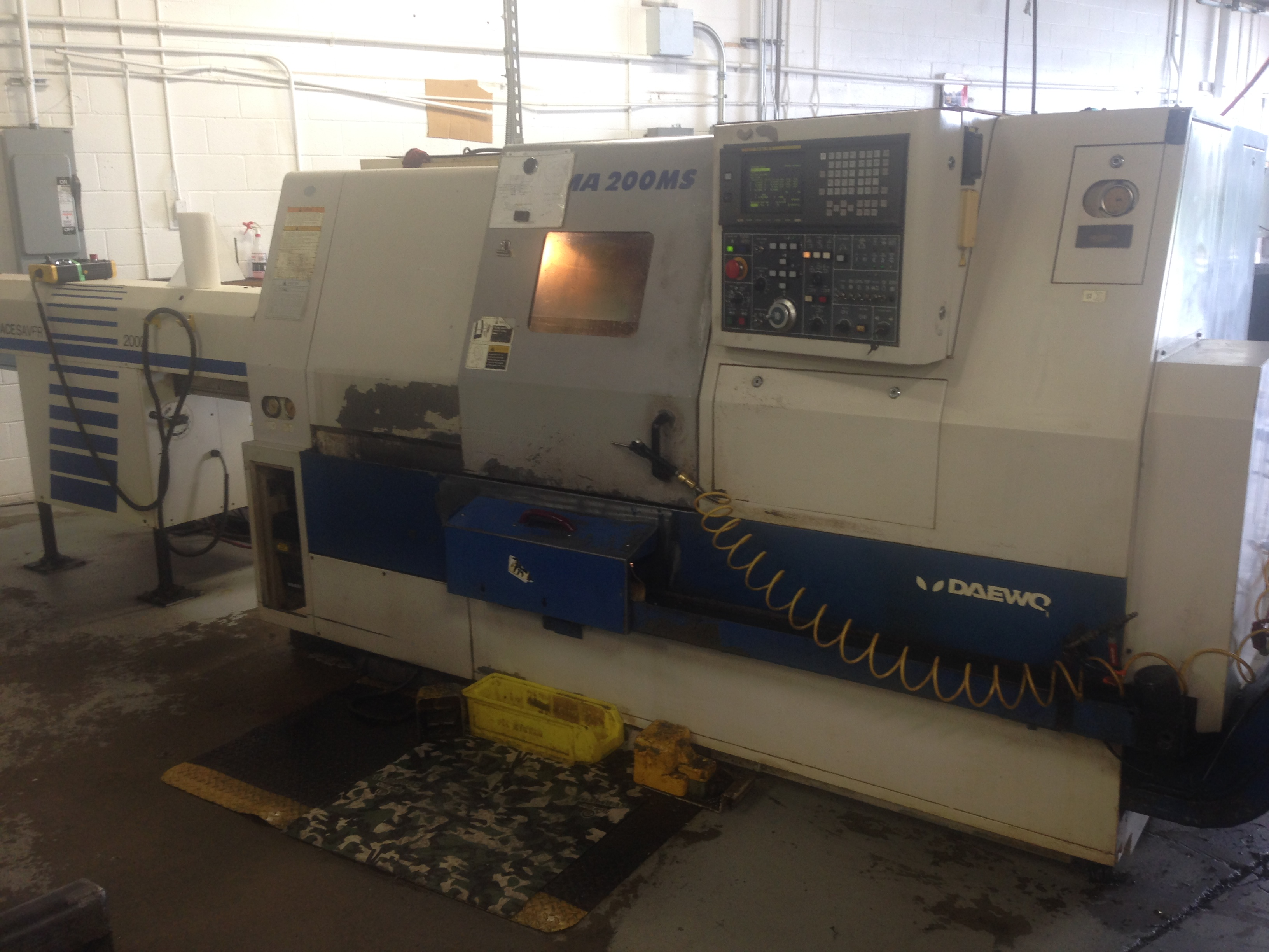 1998 Daewoo Puma 200 MS; Fanuc 18T Control; 12 Station Turret w/ Live Tools (4 Live Tools); Main Spindle & Sub Spindle w/ Collet Chucks; Parts Catcher and Conveyor;  Chip Conveyor; SMW 2000 Bar Feeder; Various Spindle Liners and Collet Pads