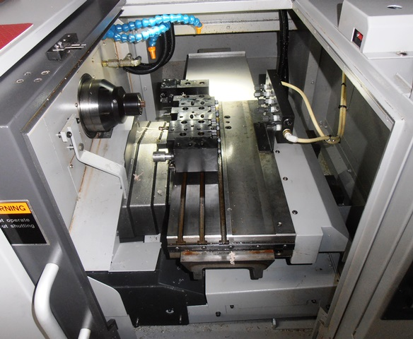 """Tsugami C300H-XZ, Fanuc 0i Mate-TD, 80-6,000 RPM, 7.3/10 Hp, 1.5"""" Max. Bar Cap, 5C Hyd. Collet Chk, 4.5""""x20.5"""" Tool Stage, Parts Catcher, Parts Conveyor, Misc Tool Holders, Coolant Manifold, 2015, Put In Service 2017, 129 Hours, Aluminum and Plastic"""