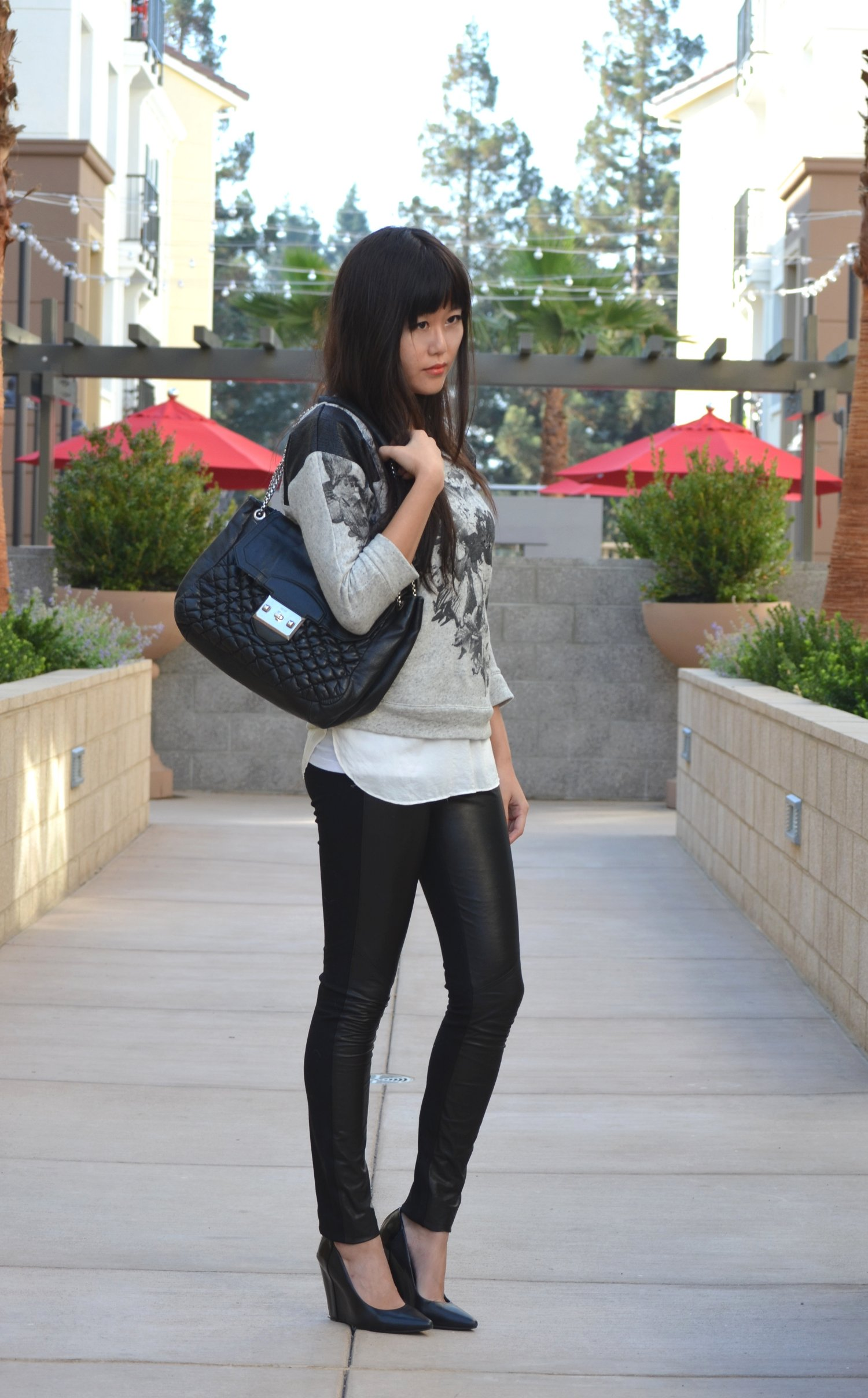 outfit with leather pants pointy wedges alexander mcqueen ziggy bag