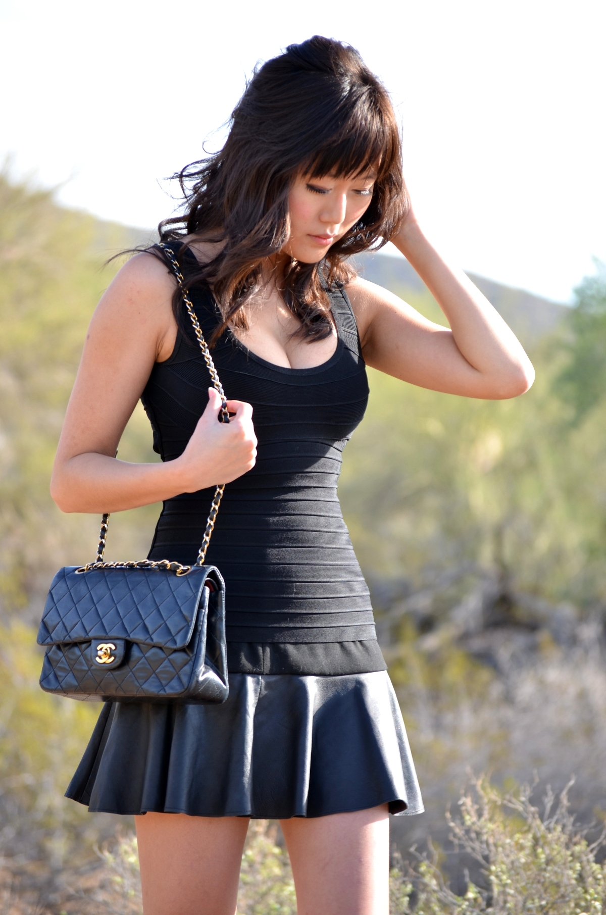 Herve Leger tight black top Asos leather flare skirt chanel vintage flap bag