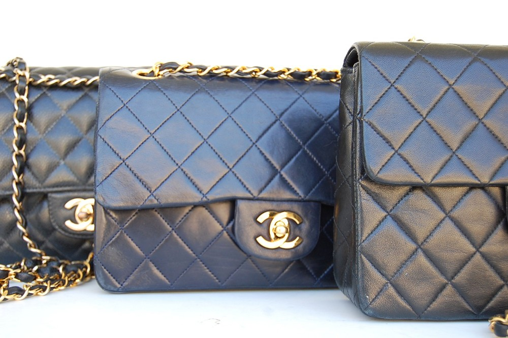 closeup of Chanel lambskin leather navy vs black