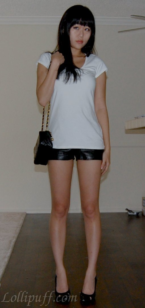 white t shirt leather shorts small shoulder purse