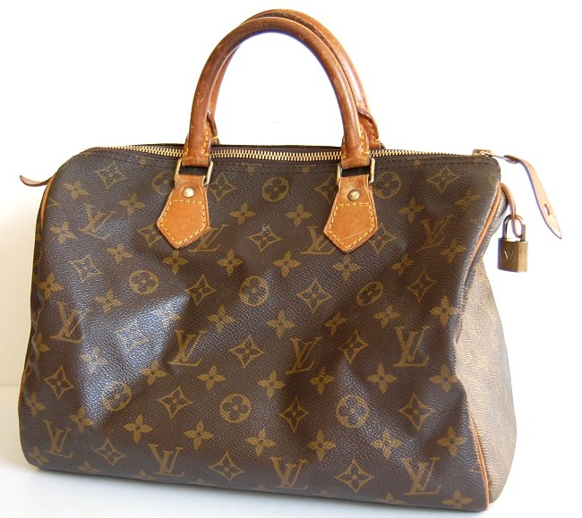 Louis Vuitton bag with polished metal hardware