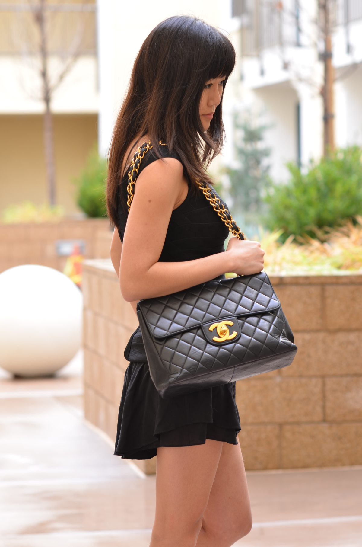 black vintage Chanel jumbo classic flap bag with big large CC gold hardware