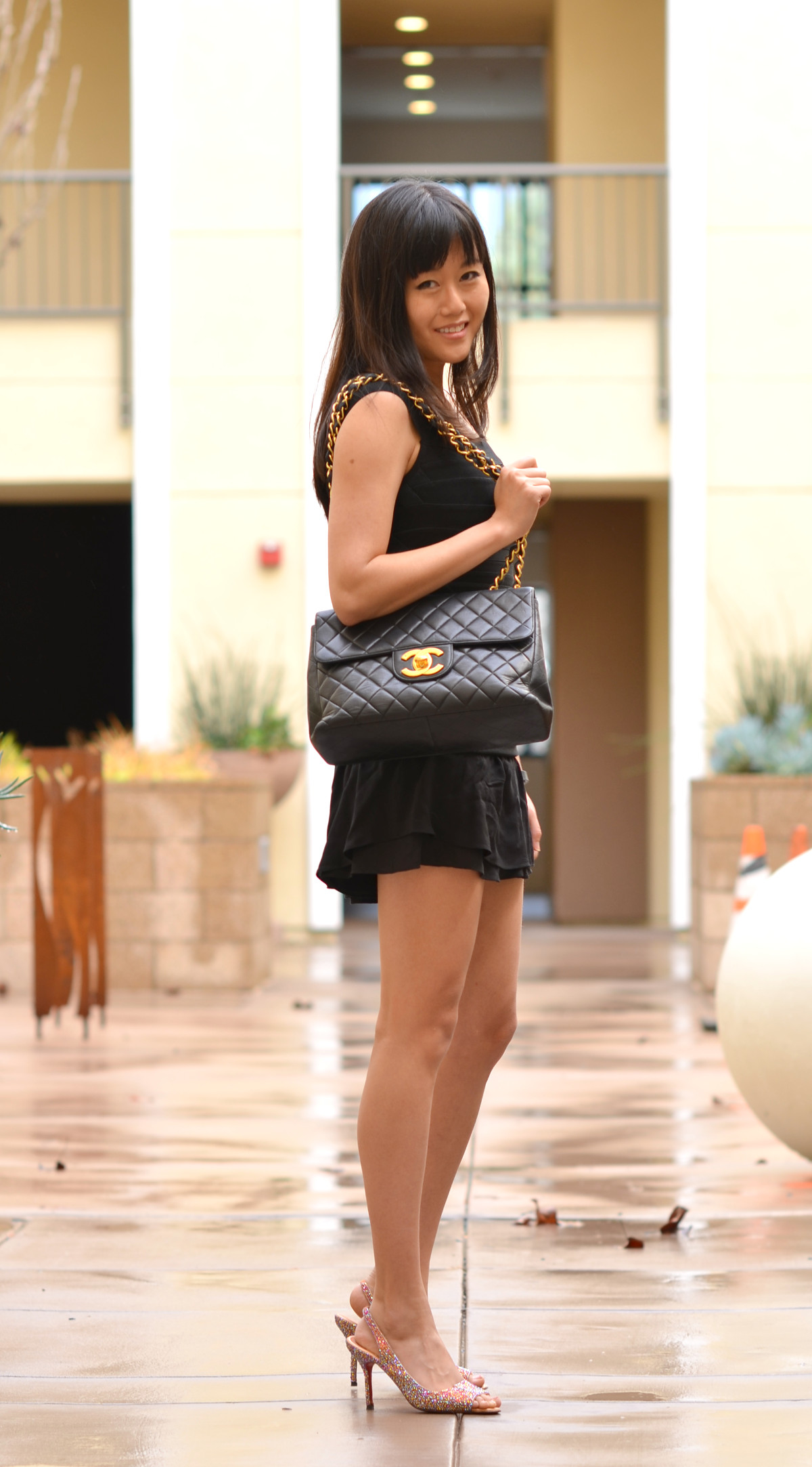 herve leger skirt smocked express skort Chanel jumbo bag strassed Christian Louboutin outfit
