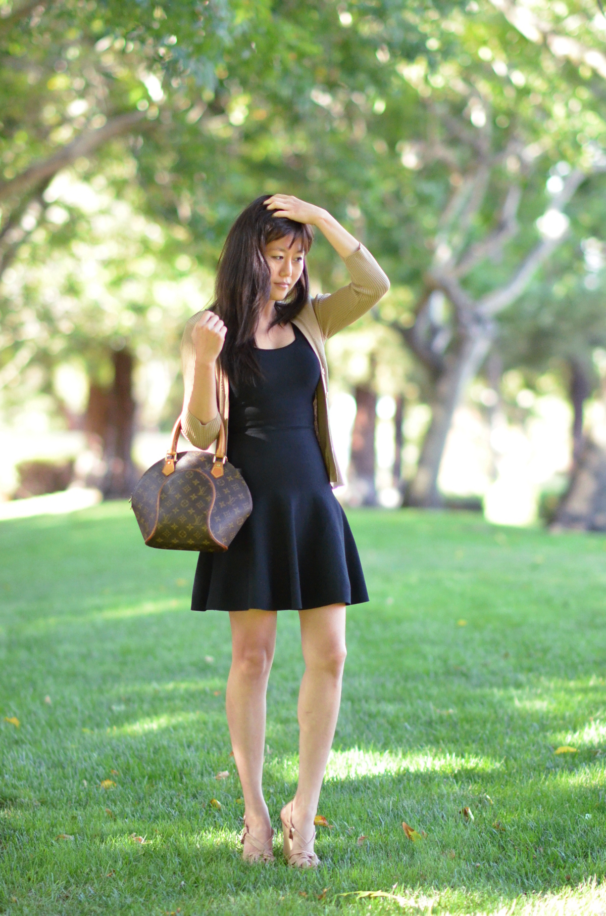 short black bcbg bandage dress and cardigan with louis vuitton ellipse pm bag handbag