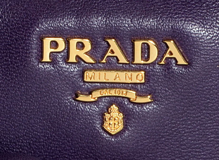 ad4b27ab1c0d09 Is this gold-tone Prada logo authentic or fake: Authentic