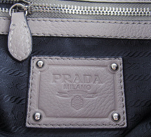 0e15a9c120df Prada Bag Authentication Using Logos
