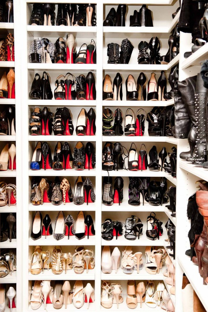 glamorous luxurious shoe closet shelves filled with designer heels and shoes