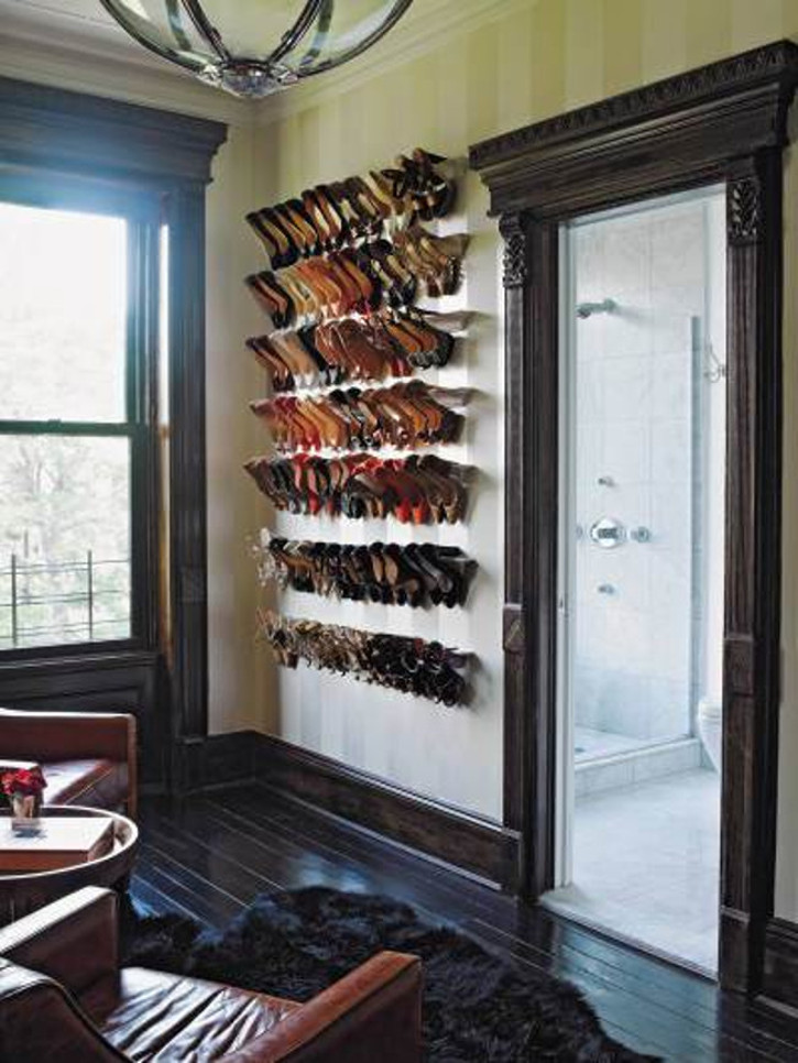 shoes hanging on statement wall crown molding shelves