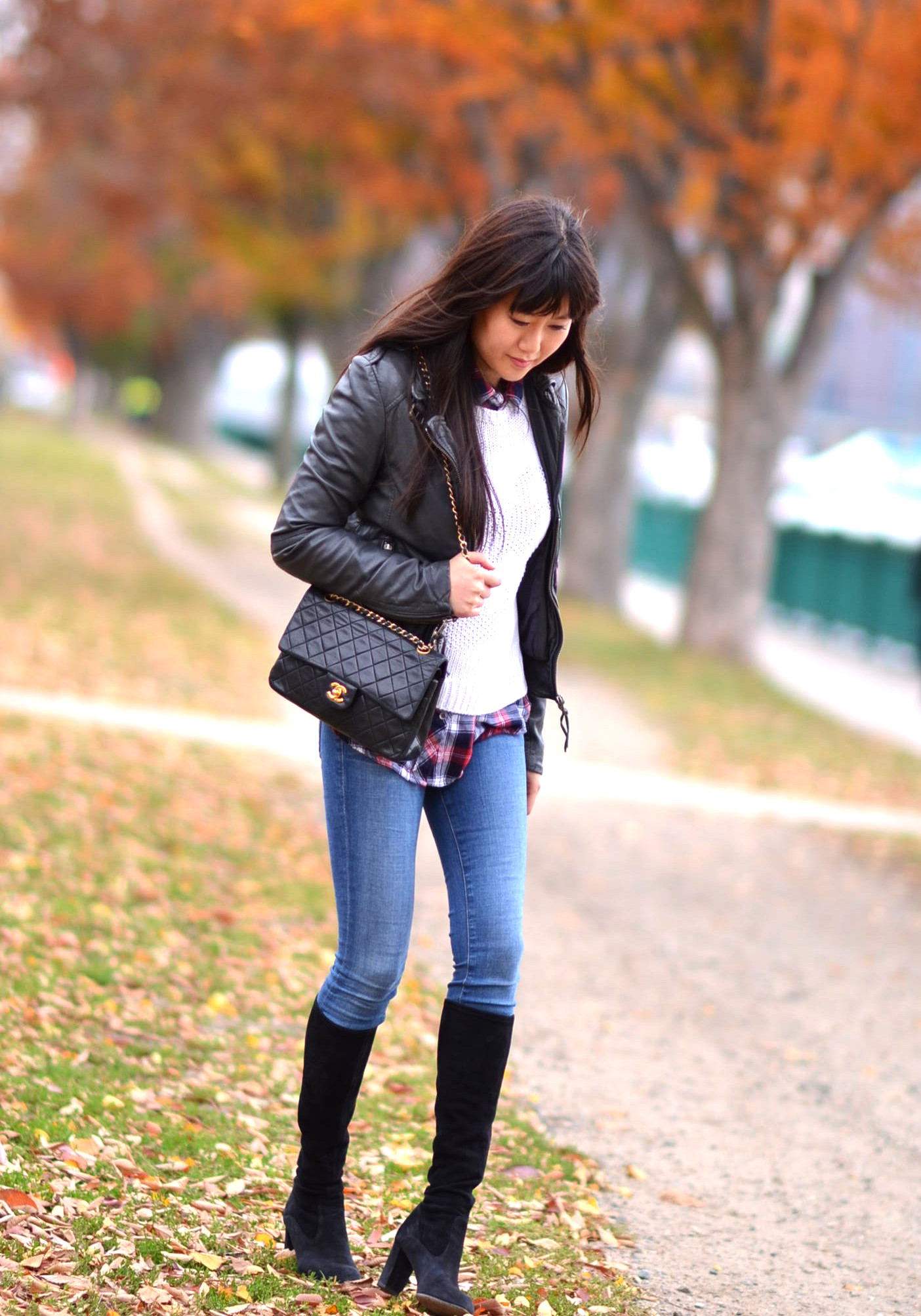 Fall outfit with sweater leather jacket and knee boots