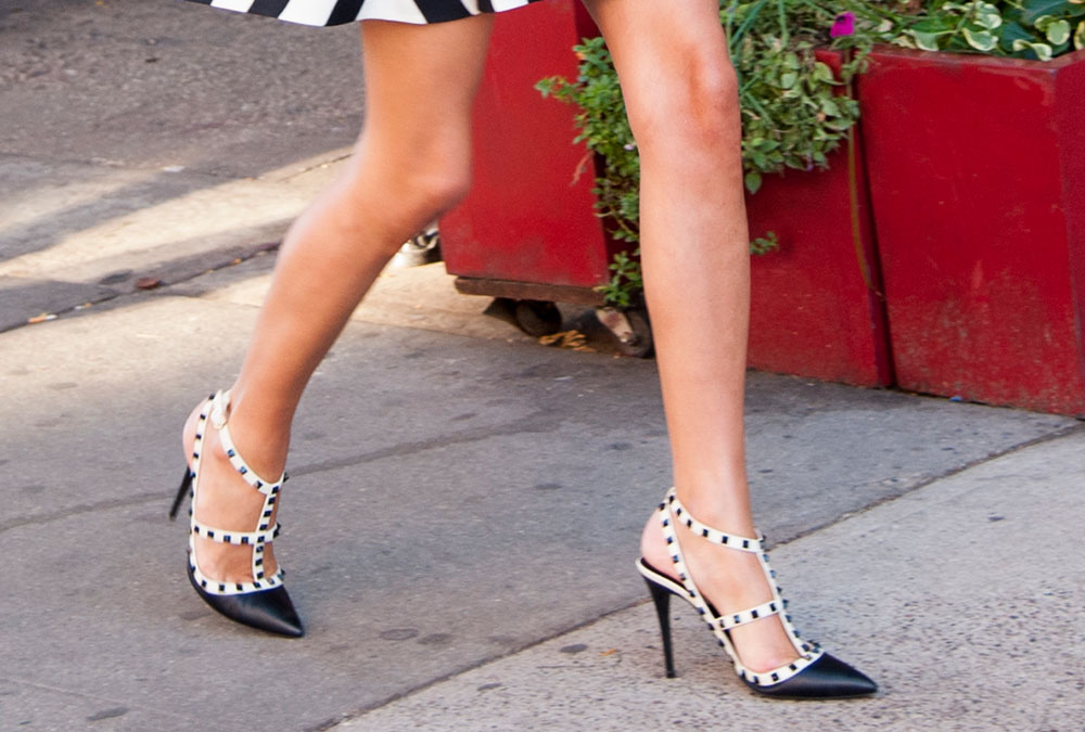 60d05dc716 celeb celebrity wearing Valentino rockstud studded spiked heels sandals  pumps caged. These gorgeous black ...