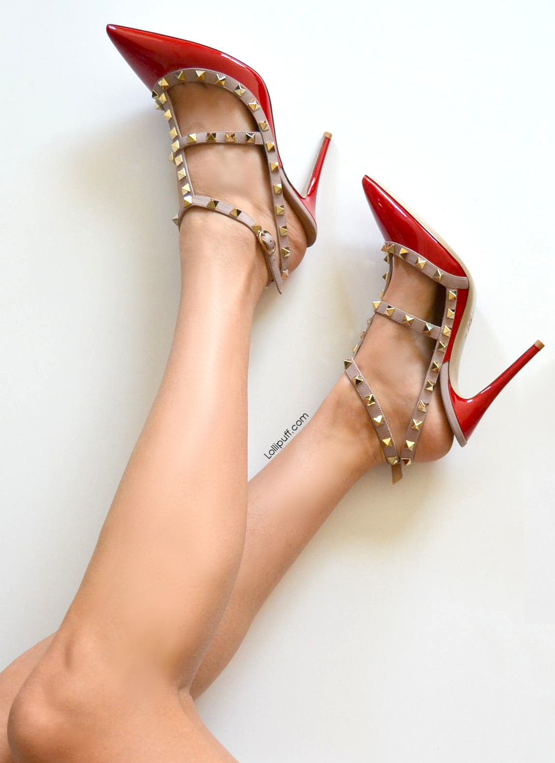 bare legs and feet wearing Valentino rockstud high heels