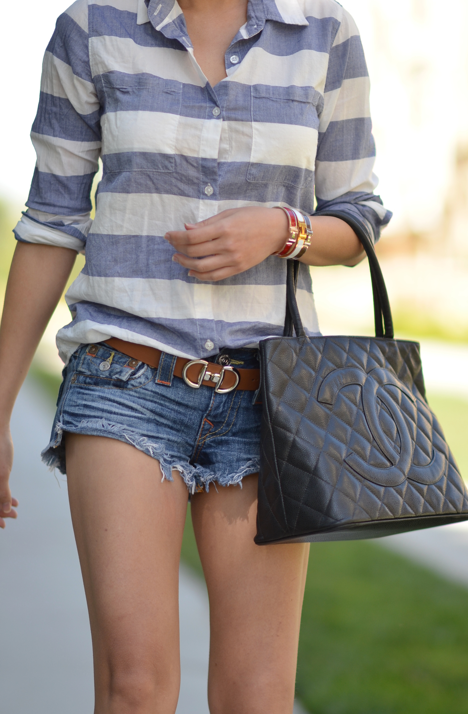 summer outfit wearing Hermes clic clac h bracelets Chanel medallion black caviar bag