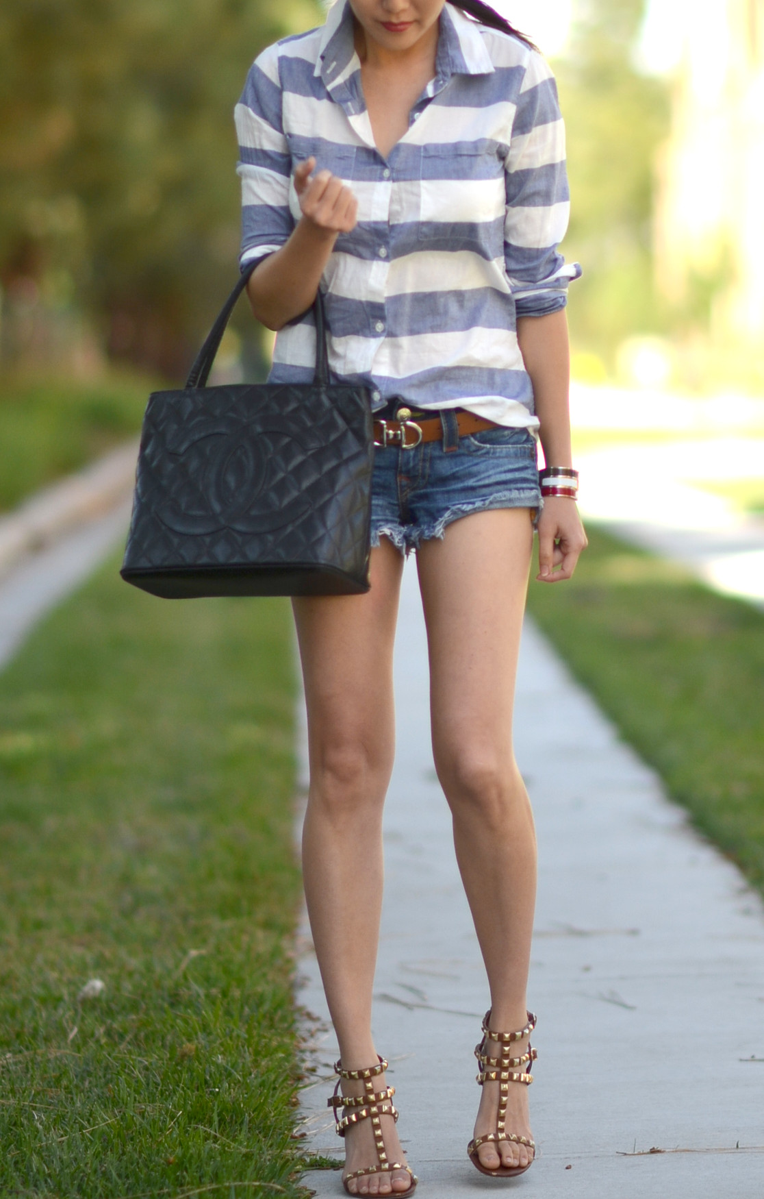 striped button up top cutoff shorts chanel handbag rockstud caged sandals outfit