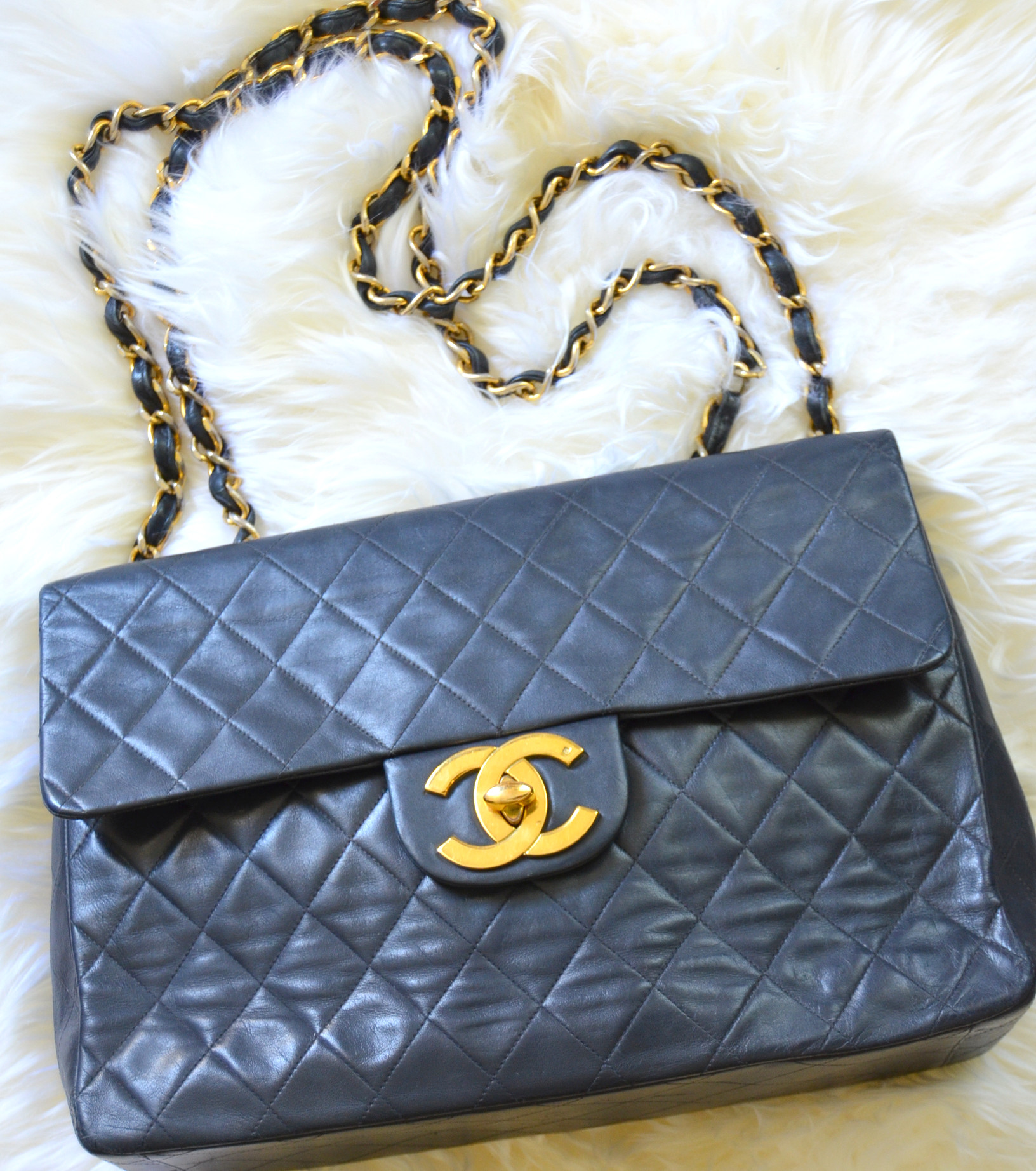 large vintage Chanel quilted flap bag with huge CC hardware