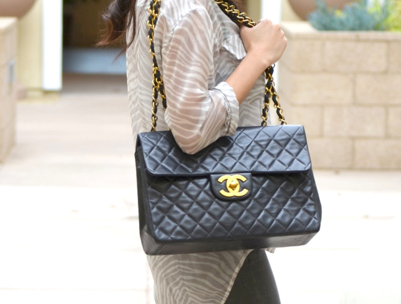 on person woman vintage large cc chanel flap bag