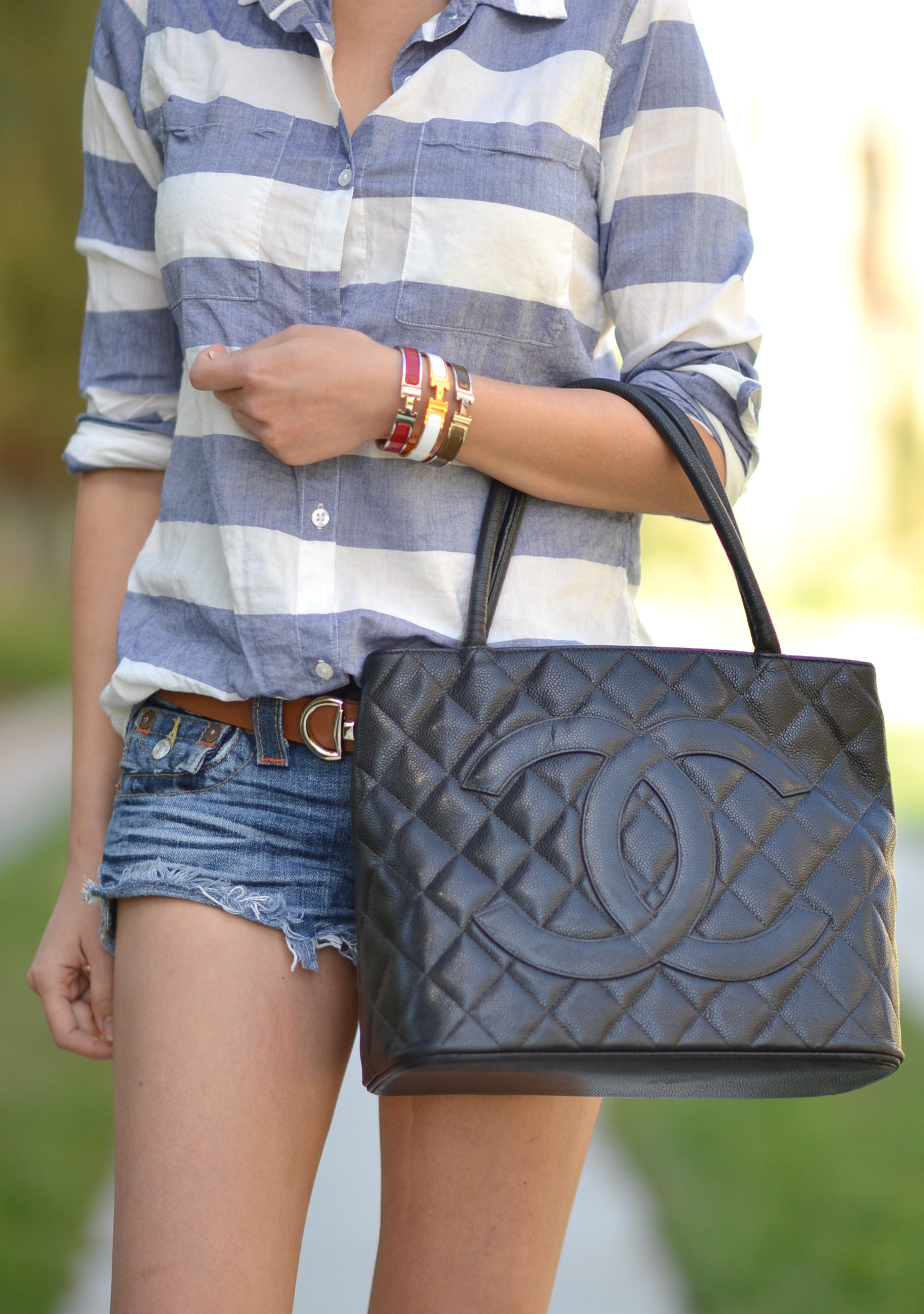 woman person girl wearing Chanel medallion handbag outfit