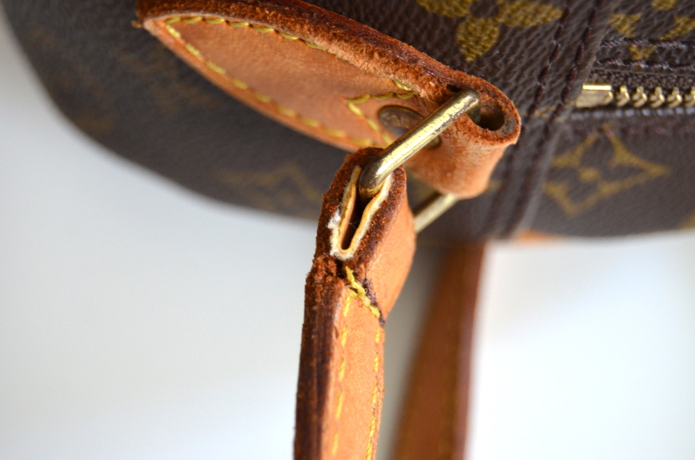 mended leather strap on handbag