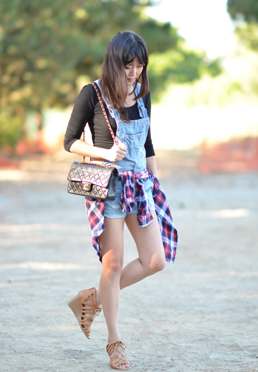 chanel quilted flap bag worn with casual denim outfit