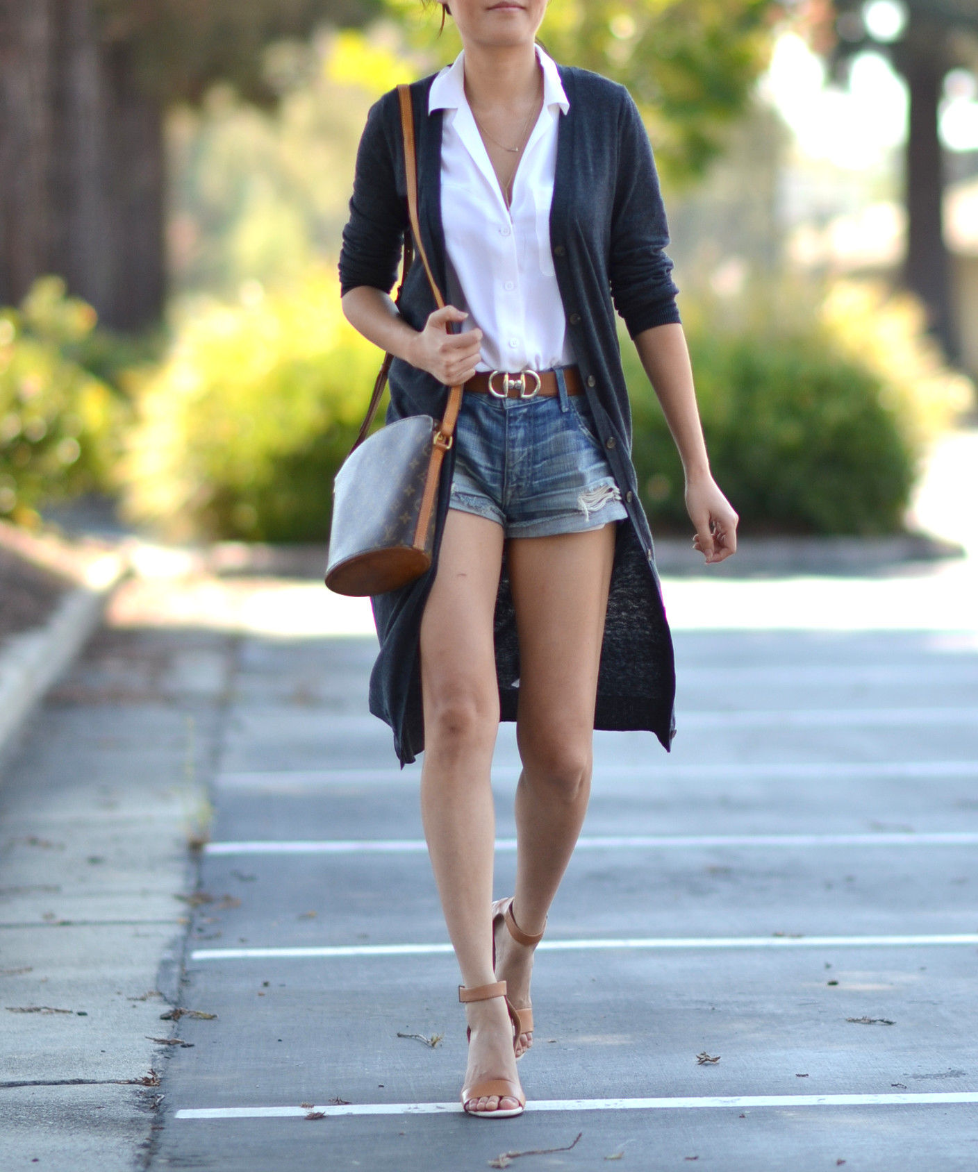 denim shorts silk blouse reversible belt long cardigan outfit with louis vuitton druout bag