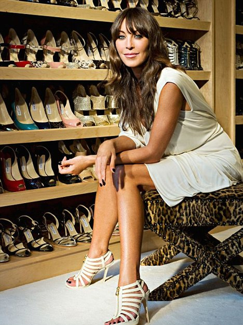 Tamara Mellon with lots of Jimmy Choo shoes