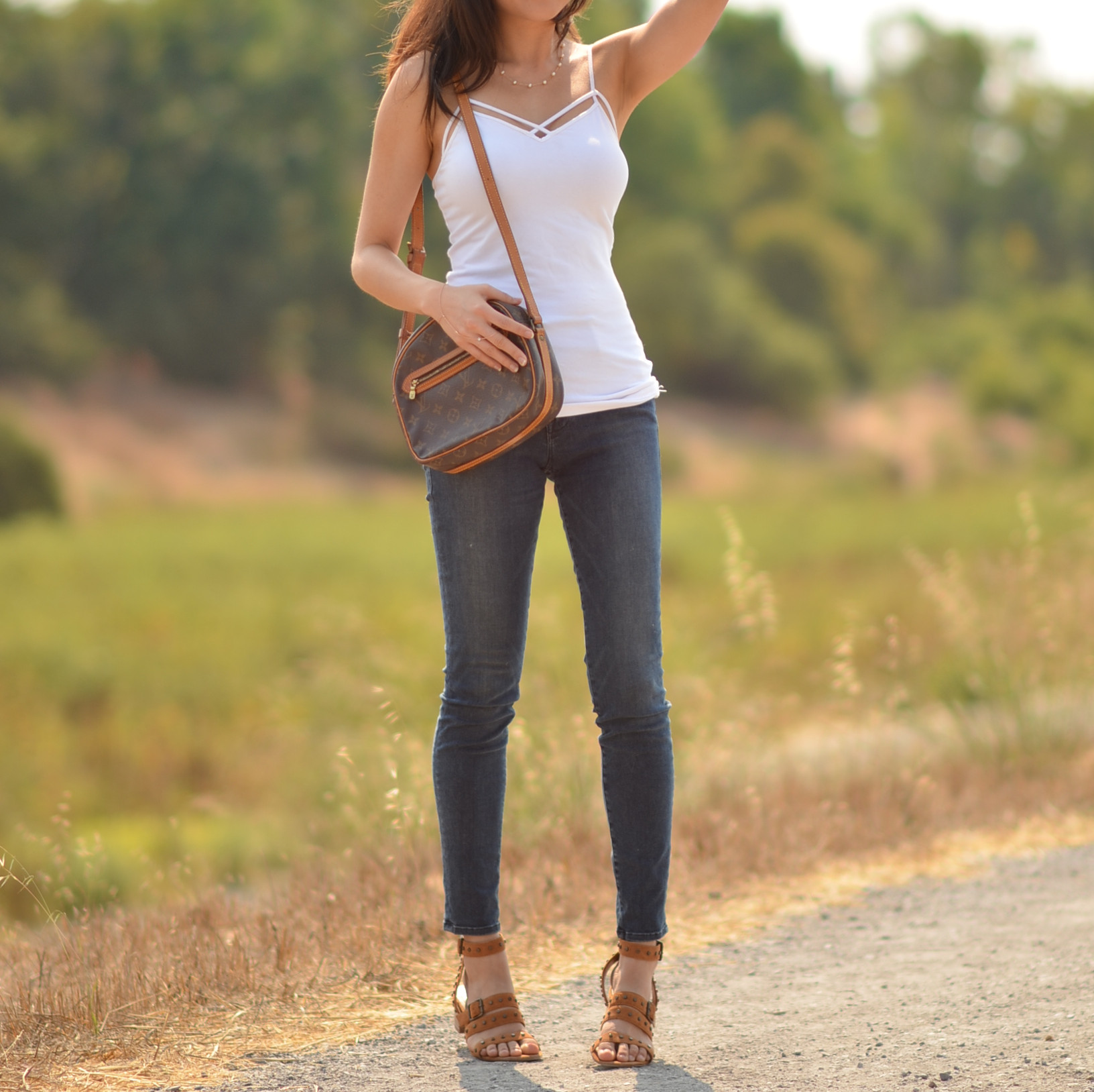 jeans white top outfit with designer Louis Vuitton shoulder bag