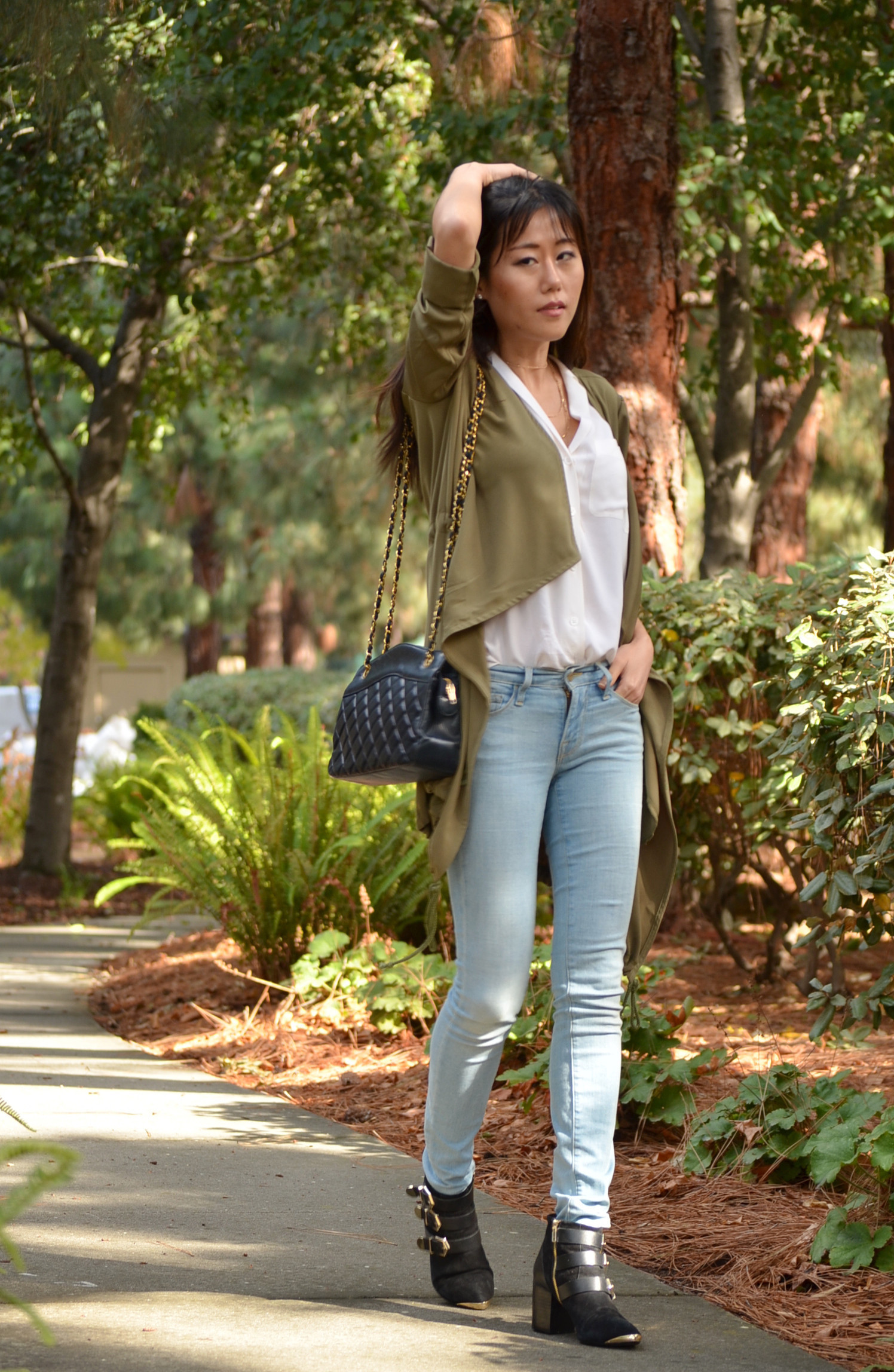 Fall outfit jeans silk top draped cardigan with Chanel bag