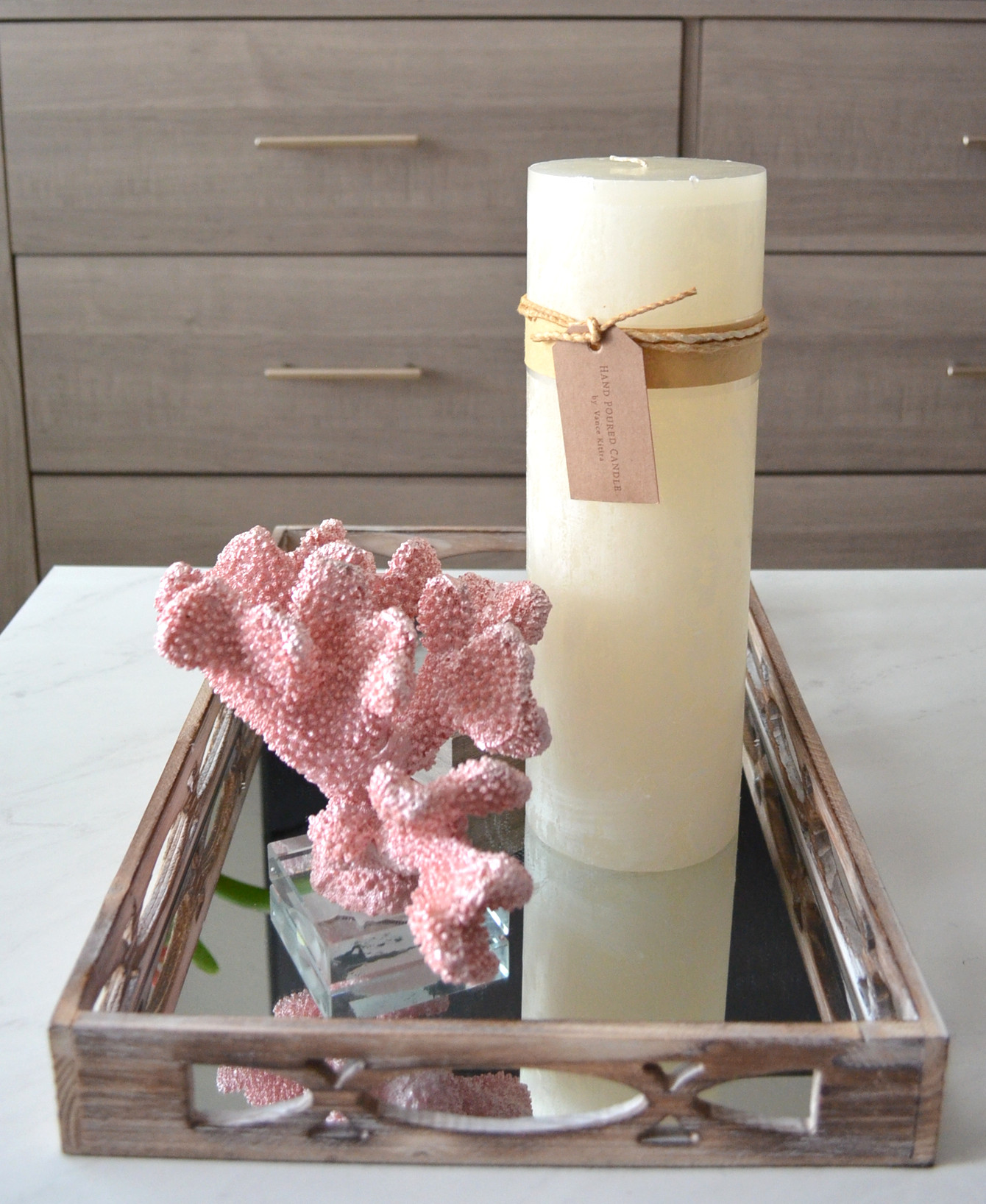 coffee table arrangement with candle mirror tray coral figurine