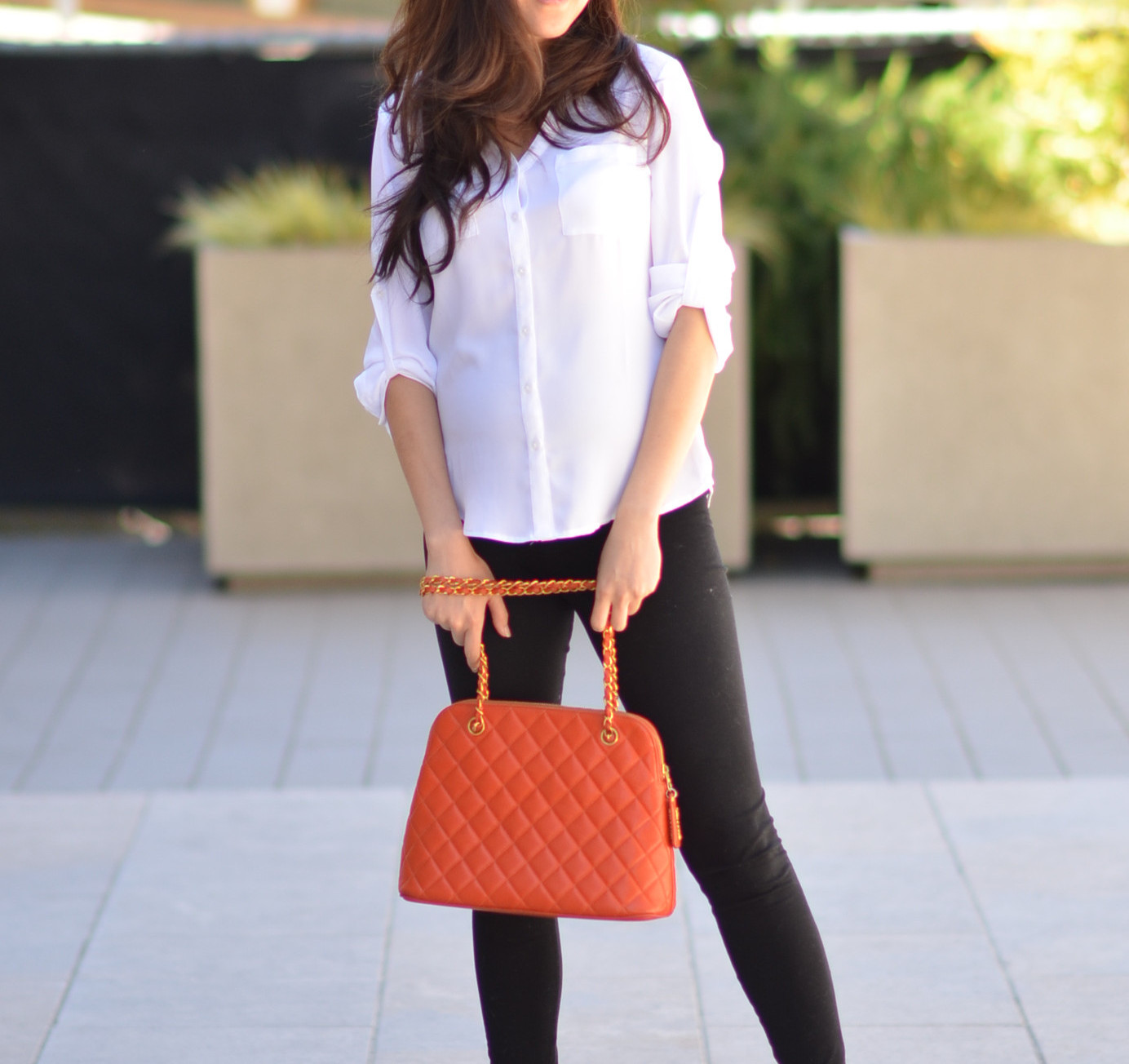wearing bright colorful chanel bag