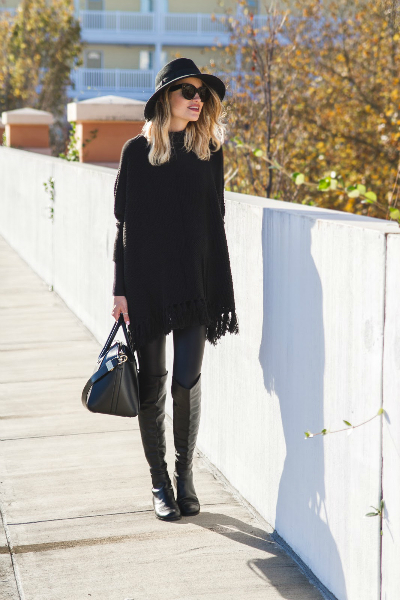 DRESSED IN ALL BLACK , oversized sweater, black, poncho, fringe, knee high boots