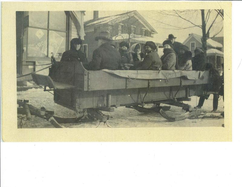 Horse drawn sled Alten family winter time on Stoney Ridge Rd. in front of Barber Shop. c.1905