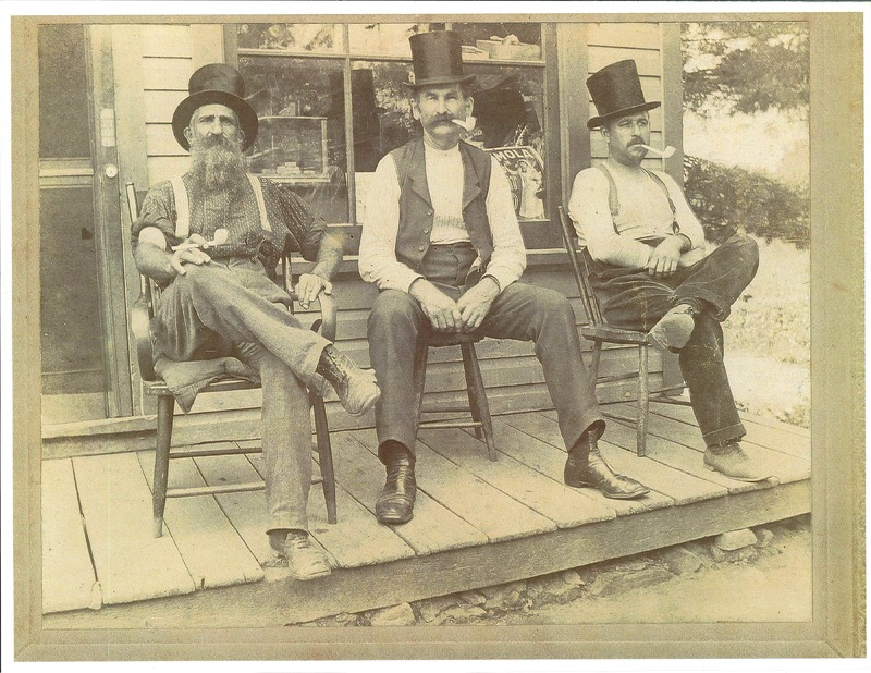 Three Avon businessmen in front of the Store Detroit Rd.  Left to right: James Brooks, Thom Warden, George Wagner c.1900