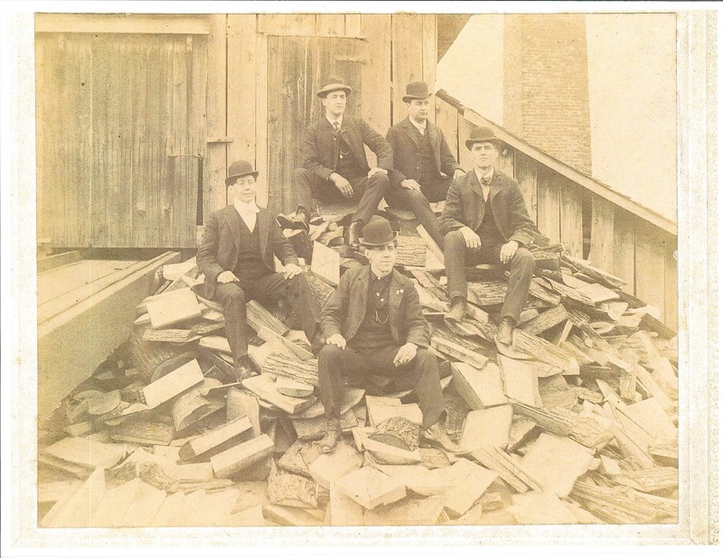 Old Mill photo men on wood pile.  Top left is Lawrence Heckel, top right is Frank Lescher, left middle is Alley Wilford, right middle is Joe Miller, bottom center is Charlie Wilford.