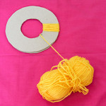Place one circle over the top of the other. Wrap your wool tightly around the circles until tightly bound.